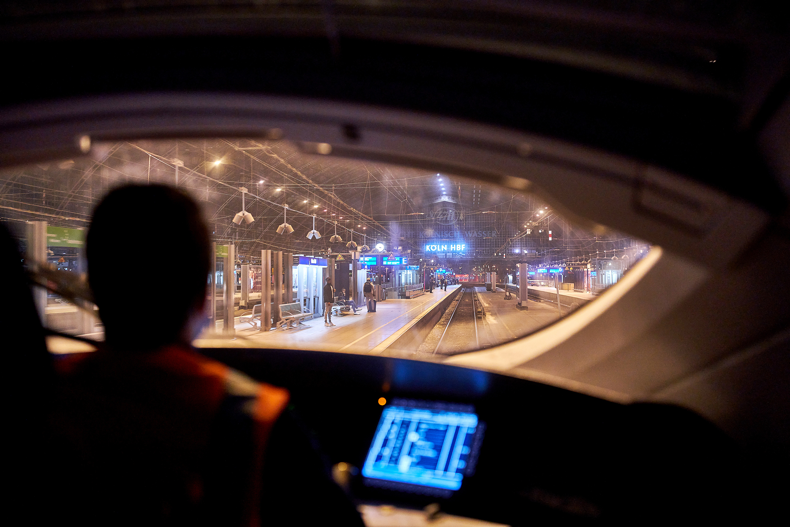 A train runner drives the first ICE to Cologne's main station shortly after 3 am. Passengers are already waiting to board.